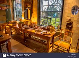Historic Kitchen Table In Old Dutch Building With Pastry And