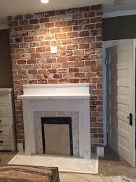 a vintage bricks fireplace installation reclaimed brick