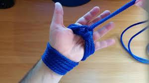 Bondage thumbs hands tied paracute cord