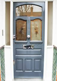 impressive solid wood front door with glass