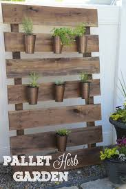 diy vertical herb garden made from a recycled wood pallet vertical garden garden wood