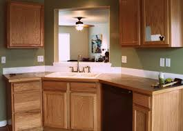 art and craft kitchen decor with on a budget butcher block kitchen counter top red oak wood cabinets and kohler brushed brass faucets