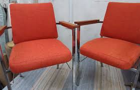 pair of 1976 gomme chairs red chrome teak arm rests and reupholstered in bute fabrics wool tweed