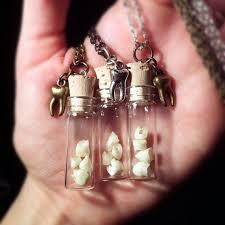 baby teeth glass vial pendant