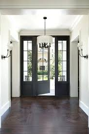 front door chandelier a black front door flanked by sidelights opens to intricate parquet wood floors front door chandelier