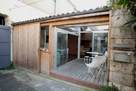 when the outside pine door of a studio apartment in bordeaux slides open the interior patio with its open air roof is revealed along with double glazed