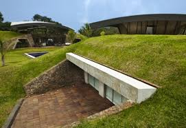 Two Homes Tucked in the Ground are Topped With Sweeping Arched Roofs in  Paraguay