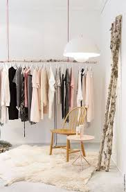 tree branch hanging clothing rack that can be hidden