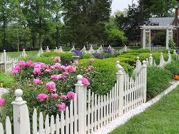 white picket fence garden border white picket fence the good life garden walk garden talk