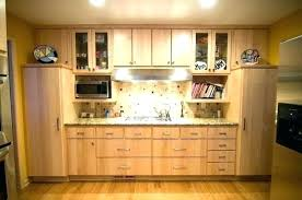 natural maple cabinets with black granite countertops light kitchen beautiful traditional