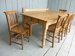 shown with a bench that we made and 5 old church chairs