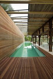 semi indoor lap pool with wooden deck