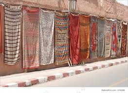texture carpets hanging on the wall of the medina in marrakesh morocco