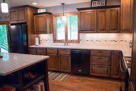quartz countertops tile backsplash luxury vinyl plank floors by precision floors and decor plymouth