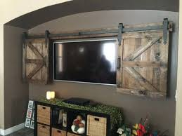 our team at nw woodennail is ever evolving to include rustic in demand home decor and after many custom requests we are adding hidden tv barn door