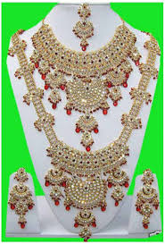 stone studded bridal set in maroon and off white