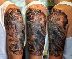 Amazing Thor Face With Skulls Tattoo On Man Right Front Shoulder