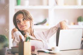 european cup office coffee. Portrait Of Cute European Lady Sitting At Office Desk With Laptop, Coffee Cup, Supplies Cup