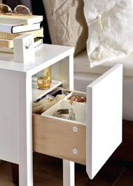 small side table with storage close up of small bedside table drawer open to reveal inside