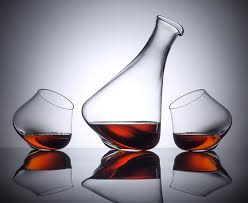 kinetic revolving decanter and glasses