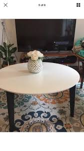 skinny round modern white and black coffee table