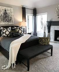 Black curtains and furniture, great way to darken up an apartment master  bedroom