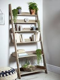 DIY LADDER SHELVES. I'd probably paint it, but simple and cute.