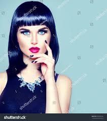 high fashion model portrait with trendy fringe hair style make up and manicure