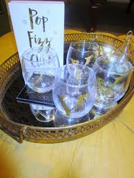 diy personalized wine glasses on a tray