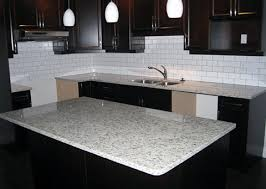 moon white granite countertops with dark wood kitchen cabinets