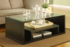 top glass wooden framed modern coffee table four sliding storages drawers black white colors combo
