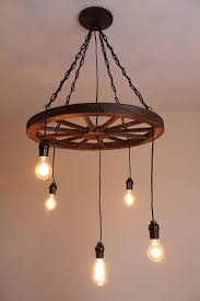gorgeous diy wagon wheel chandelier 25 best ideas about wagon wheel light on wagon wheel