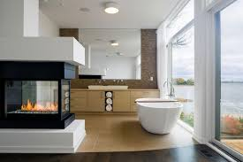 cool bathroom design with white oval bathtub and modern electric fireplace ideas