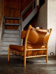 view this item and discover similar lounge chairs at buffalo leather upholstered inca chair with buckles on a beech frame designed by arne norell