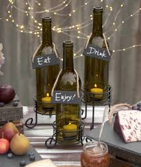 Our set of three wine bottle lights with variably sized votive candle holder  stands work beautifully
