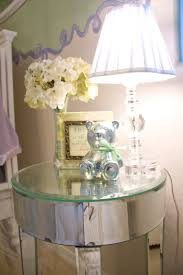 saving small teenage bedroom spaces with narrow glass top round mirrored nightstand plus acrylic bedside table lamp ideas