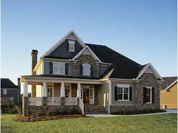 french country home plan with wrap around porches