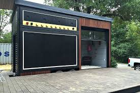 tiny house with garage. the foundation-built main house isn\u0027t as unique, but it\u0027s also very nicely designed, with high ceilings and a glass garage door that make it feel lot tiny q