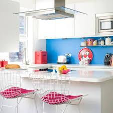 white kitchen with blue splashback