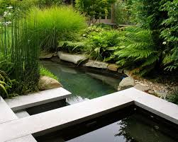 Modern Garden Ponds Design A water fountain makes a yard interesting