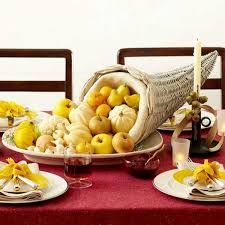 View in gallery Gorgeous Thanksgiving table decorations with fresh fruits  and pumpkin