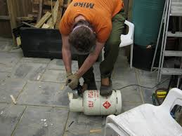 mike cutting off the top ring with an angle grinder