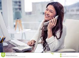 Smiling Asian Woman On Phone Call Using Computer Stock Photo Image