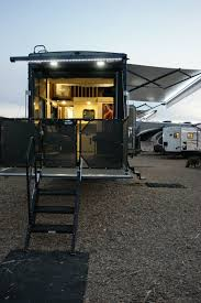 this triple axle luxury toyhauler offers a 13 garage perfect tv placement plenty of seating for the whole family u shaped kitchen outdoor kitchen