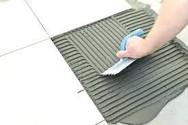 floor prep for vinyl tiles preparing concrete floor for tile laying ceramic tiles troweling mortar onto