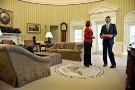 obama oval office. Julia Gillard Shows Barack Obama An Australian Rules Football In The Oval Office. Office