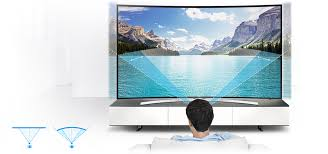 samsung curved tv in living room. the screen is curved at right angle to provide optimal viewing distance for your living room. also, gently gives you uniform and samsung tv in room