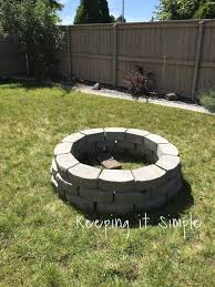 nice grass fire pit with pavers round shape
