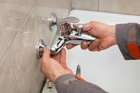 bathroom remodeling annapolis. Plumber Hands Fixing Water Tap In A Bathroom Remodeling Annapolis