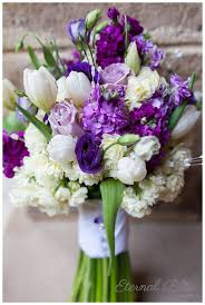 Stunning bouquet with purple and white flowers, including roses, tulips,  and a whole